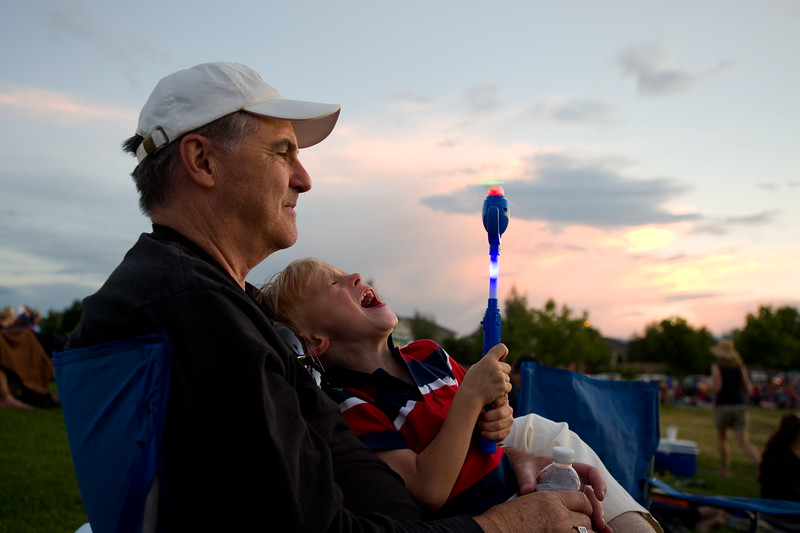 "David Baker sits with his grandson Oliver Chrastek, 4, as he sings at the top of his lungs while waiting for the fireworks to begin during the July 3rd Extravaganza at the Colorado National Golf Club in Erie on Sunday. <br /> More photos:  <a href=""http://www.dailycamera.com"">http://www.dailycamera.com</a><br /> (Autumn Parry/Staff Photographer)<br /> July 3, 2016"