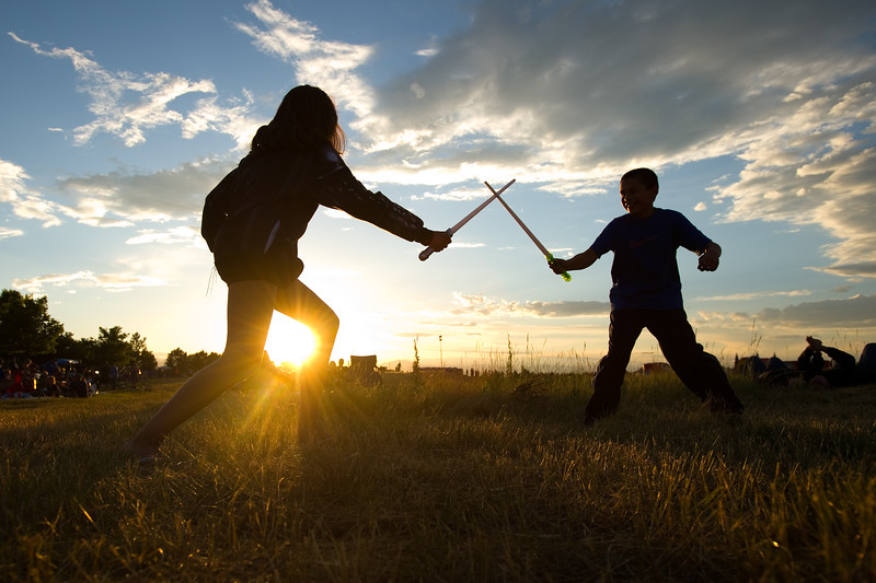 "Kamren Miller (left) and her brother Gregory Miller play with light sabers as they wait for the fireworks to begin during the July 3rd Extravaganza at the Colorado National Golf Club in Erie on Sunday. <br /> More photos:  <a href=""http://www.dailycamera.com"">http://www.dailycamera.com</a><br /> (Autumn Parry/Staff Photographer)<br /> July 3, 2016"