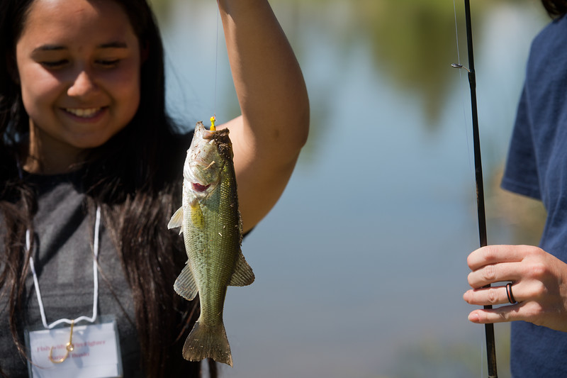 """Marisol Bucio, 13, holds up her catch of a bass during the first """"Fish with a Firefighter"""" event held by the Breakfast Optimists Club, city of Longmont, and Kids Fishing Incorporated, at Izaac Walton pond in Longmont on Saturday. <br /> More photos:  <a href=""""http://www.dailycamera.com"""">http://www.dailycamera.com</a><br /> (Autumn Parry/Staff Photographer)<br /> June 4, 2016"""