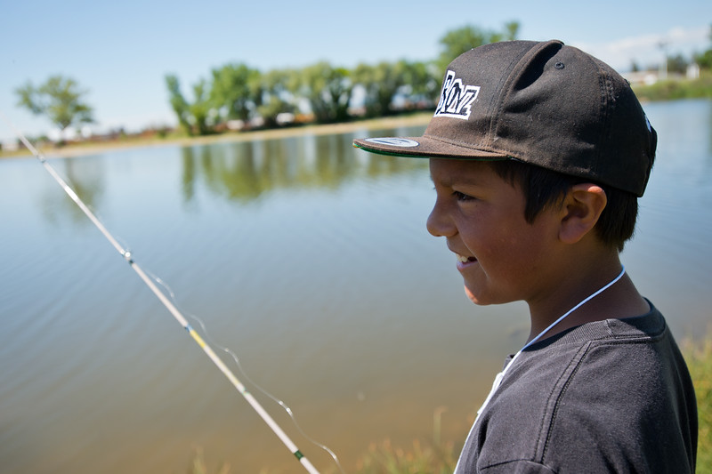 "Justin Rodriguez, 13, waits for a fish to bite during the first ""Fish with a Firefighter"" event held by the Breakfast Optimists Club, city of Longmont, and Kids Fishing Incorporated, at Izaac Walton pond in Longmont on Saturday. <br /> More photos:  <a href=""http://www.dailycamera.com"">http://www.dailycamera.com</a><br /> (Autumn Parry/Staff Photographer)<br /> June 4, 2016"