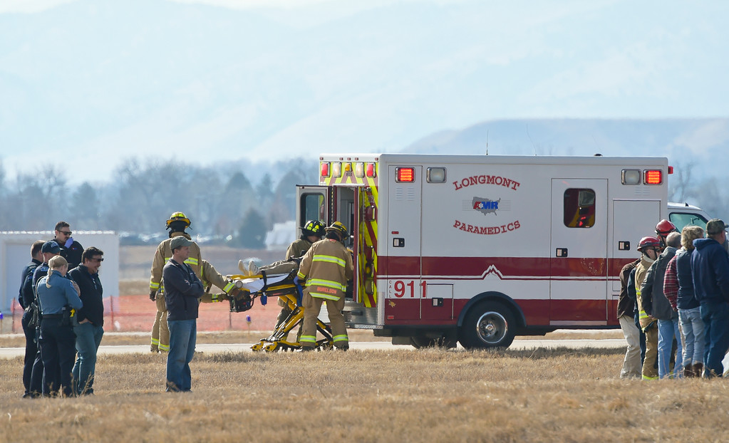 . A person is placed in an ambulance after an airplane flipped onto its roof at Vance Brand Municipal Airport Friday afternoon. To view more photos and a video visit timescall.com. Lewis Geyer/Staff Photographer Feb. 16, 2018