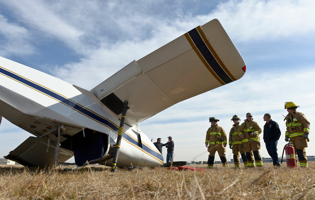 . An airplane lies on its roof along the runway at Vance Brand Municipal Airport Friday afternoon. To view more photos and a video visit timescall.com. Lewis Geyer/Staff Photographer Feb. 16, 2018