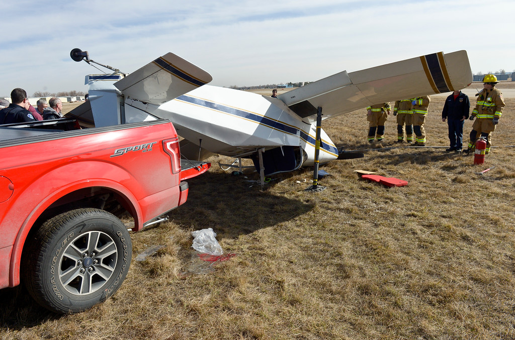 . A pickup was used to prop up the back of an airplane after it flipped onto its roof at Vance Brand Municipal Airport Friday afternoon. To view more photos and a video visit timescall.com. Lewis Geyer/Staff Photographer Feb. 16, 2018