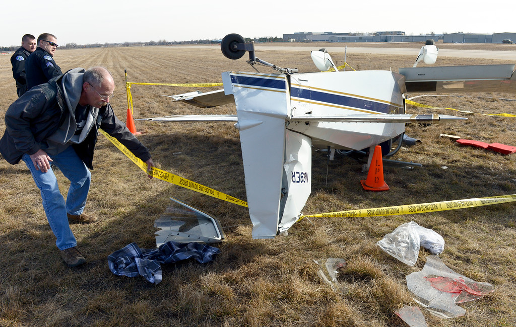 . Yellow tape is place around an airplane after it flipped onto its roof along the runway at Vance Brand Municipal Airport Friday afternoon. To view more photos and a video visit timescall.com. Lewis Geyer/Staff Photographer Feb. 16, 2018