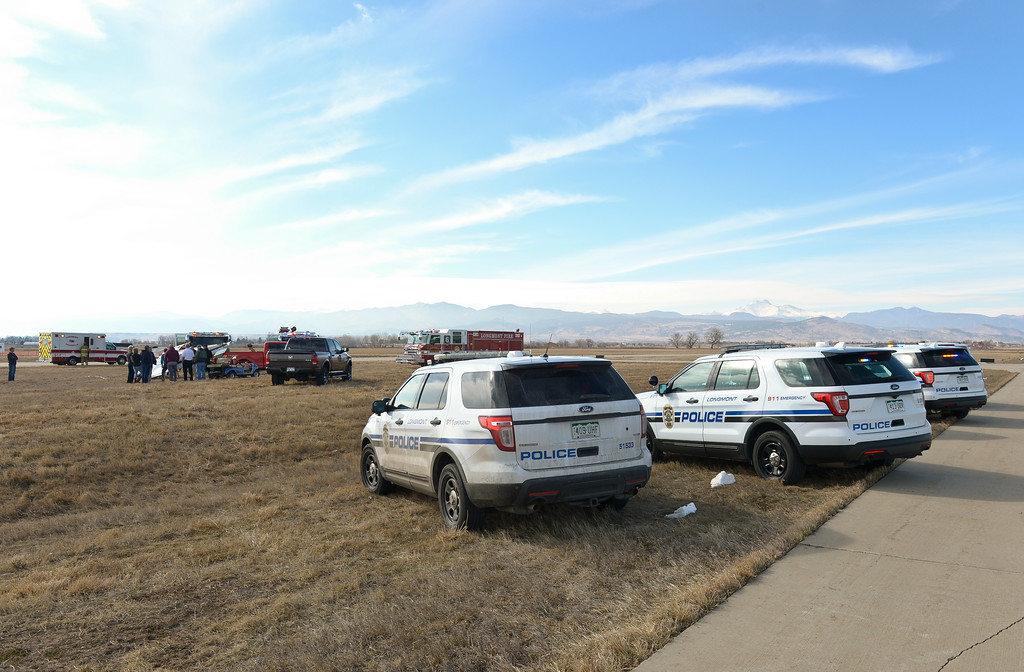 . Longmont police cars at the scene where an airplane flipped onto its roof at Vance Brand Municipal Airport Friday afternoon. To view more photos and a video visit timescall.com. Lewis Geyer/Staff Photographer Feb. 16, 2018