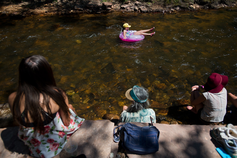 "Amelia Olgren, 9, rides down the North Saint Vrain Creek in a tube during the Folks Fest in Lyons on Sunday. <br /> More photos:  <a href=""http://www.dailycamera.com"">http://www.dailycamera.com</a><br /> (Autumn Parry/Staff Photographer)<br /> August 21, 2016"