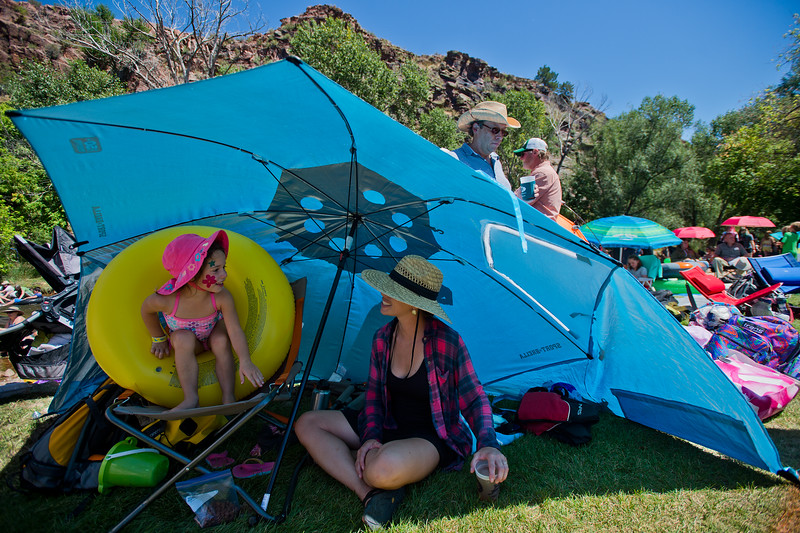 "Heather Montross-Cowan sits in the shade with her daughter Elsie Cowan, 4, as they listen to music at the Folks Fest in Lyons on Sunday. <br /> More photos:  <a href=""http://www.dailycamera.com"">http://www.dailycamera.com</a><br /> (Autumn Parry/Staff Photographer)<br /> August 21, 2016"
