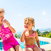 Two adorable children eating yoghurt