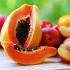 sliced papaya and mangoes fruits on the table.