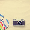 Colorful flip flops and vintage camera