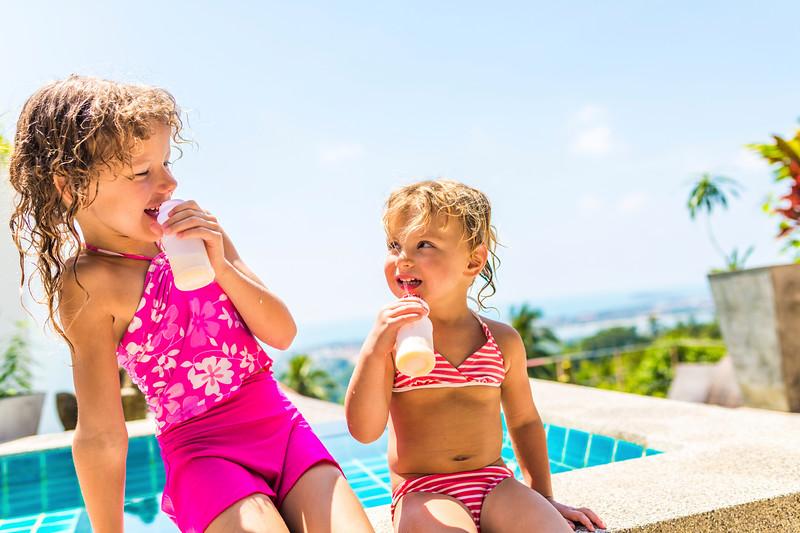 Two adorable children eating yoghurt