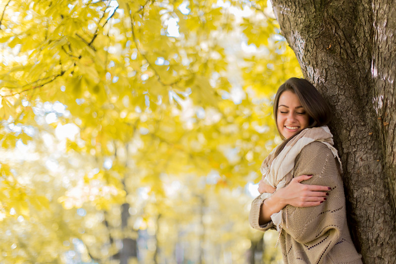 Young woman at autumn forest