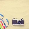 Colorful flip flops and vintage camera