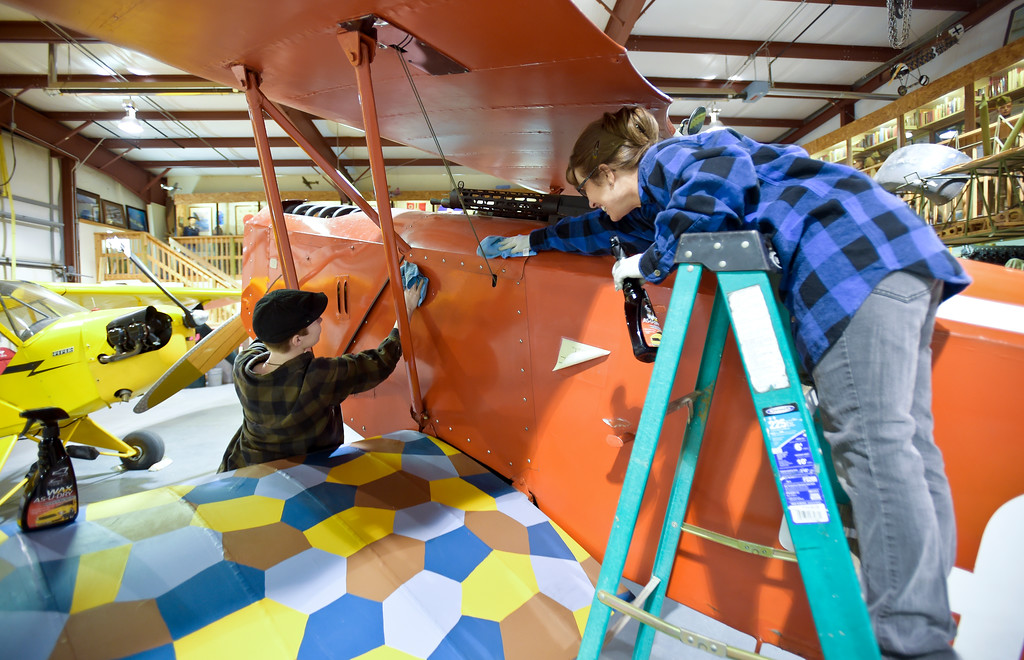 . Julie Kinder, 17, left, and her mother Rebecca Kinder clean the fuselage of a replica WWI biplane at the Vintage Aero Flying Museum near Fort Lupton Tuesday. To view a video and a slideshow visit timescall.com. Lewis Geyer/Staff Photographer Nov. 07, 2017