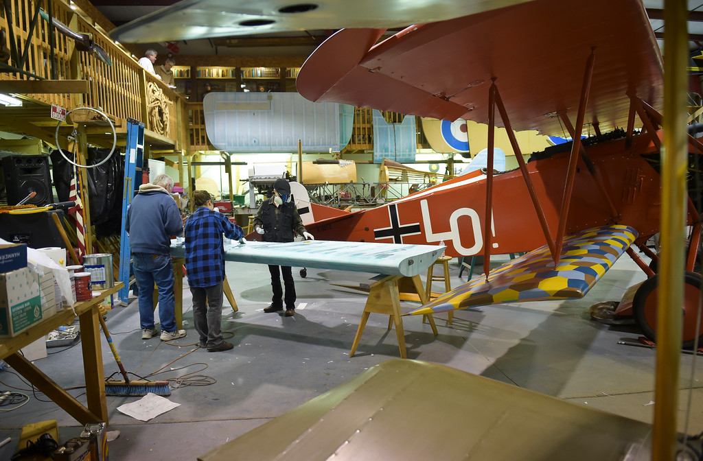 . From left: Tom Kooken, Rebecca Kinder, and her daughter Julie Kinder, 17, apply fabric to a wing for a biplane at the Vintage Aero Flying Museum near Fort Lupton Tuesday. To view a video and a slideshow visit timescall.com. Lewis Geyer/Staff Photographer Nov. 07, 2017