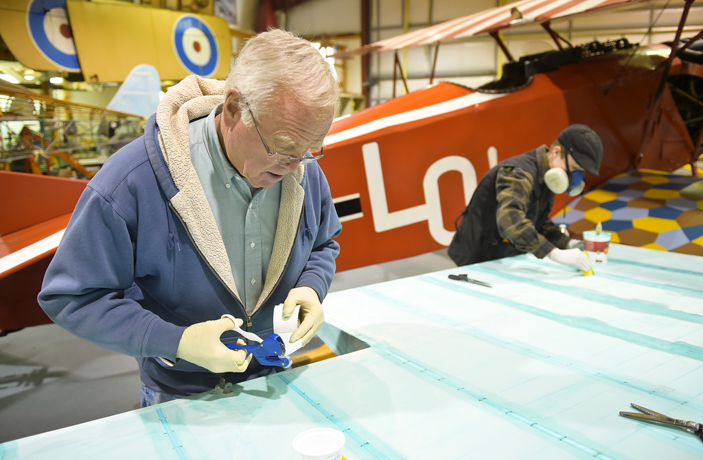 . Tom Kooken and Julie Kinder, 17, work on a wing for a biplane at the Vintage Aero Flying Museum near Fort Lupton Tuesday. To view a video and a slideshow visit timescall.com. Lewis Geyer/Staff Photographer Nov. 07, 2017