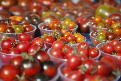 Cherry tomatoes sit in containers at the Fortuna Farmers Market on Tuesday. (Shaun Walker -- The Times-Standard)
