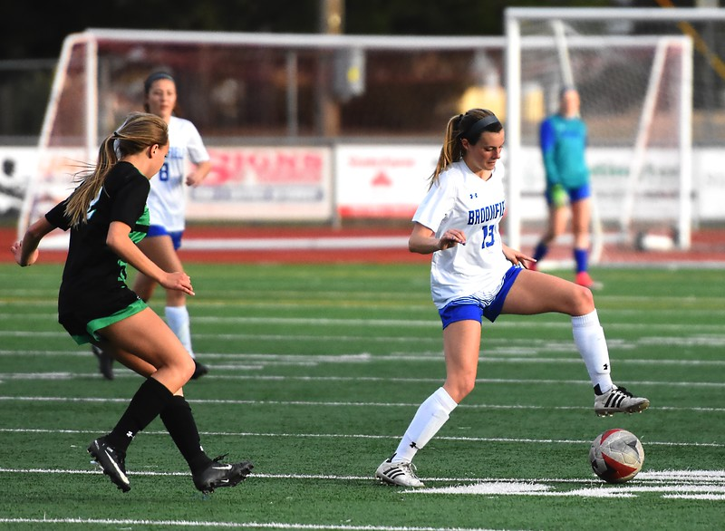 Broomfield's Jessie Mooney turns with the ball during the Eagles' game against Fossil Ridge on Tuesday, April 10, at Broomfield High School.