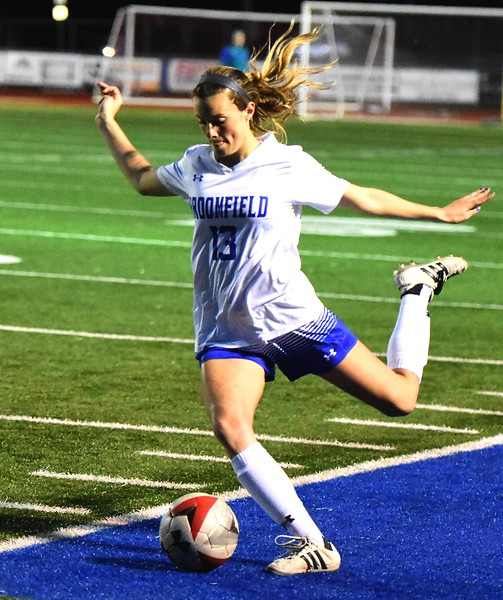 Broomfield's Jessie Mooney lines up a cross during the Eagles' game against Fossil Ridge on Tuesday, April 10, at Broomfield High School.