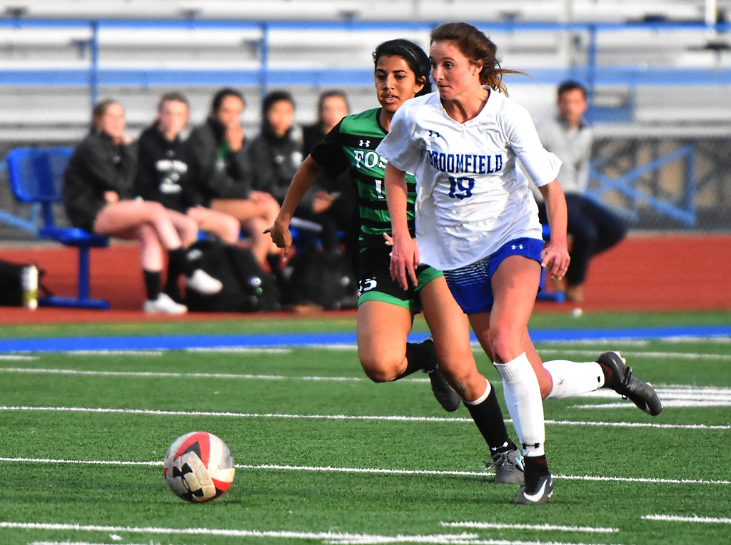 . Broomfield\'s Hailey Stodden breaks free of the defense during the Eagles\' game against Fossil Ridge on Tuesday, April 10, at Broomfield High School.