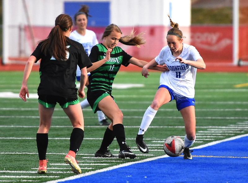 Broomfield's Ashley Tuccio fends off a defender during the Eagles' game against Fossil Ridge on Tuesday, April 10, at Broomfield High School.