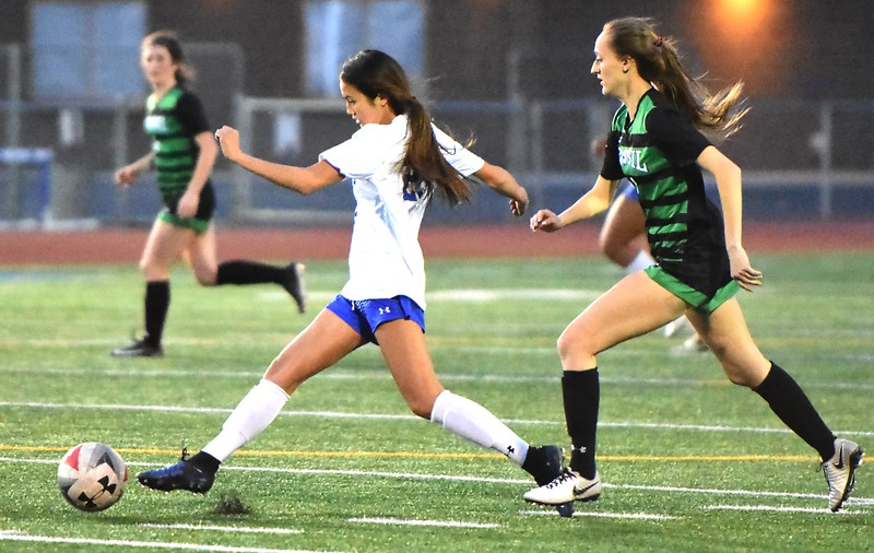 Broomfield's Isabel Magalong works to get past a defender during the Eagles' game against Fossil Ridge on Tuesday, April 10, at Broomfield High School.