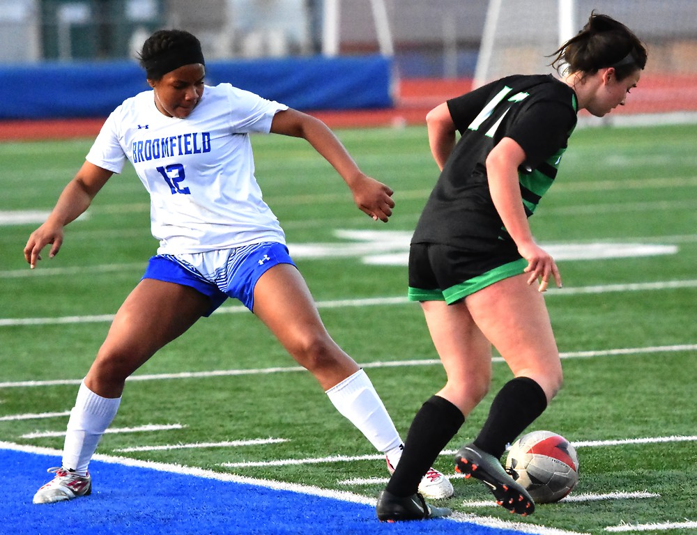 . Broomfield\'s Daisha Knowles challenges a offensive player during the Eagles\' game against Fossil Ridge on Tuesday, April 10, at Broomfield High School.