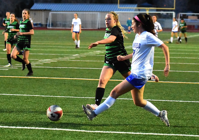Broomfield's Isabelle Sorge passes to a teammate during the Eagles' game against Fossil Ridge on Tuesday, April 10, at Broomfield High School.