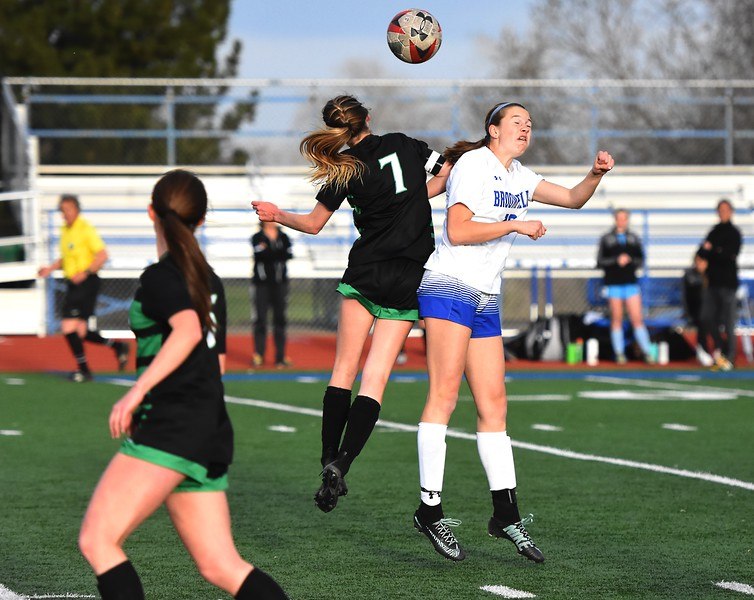 Broomfield's Shaylee Gailus goes up for a header during the Eagles' game against Fossil Ridge on Tuesday, April 10, at Broomfield High School.