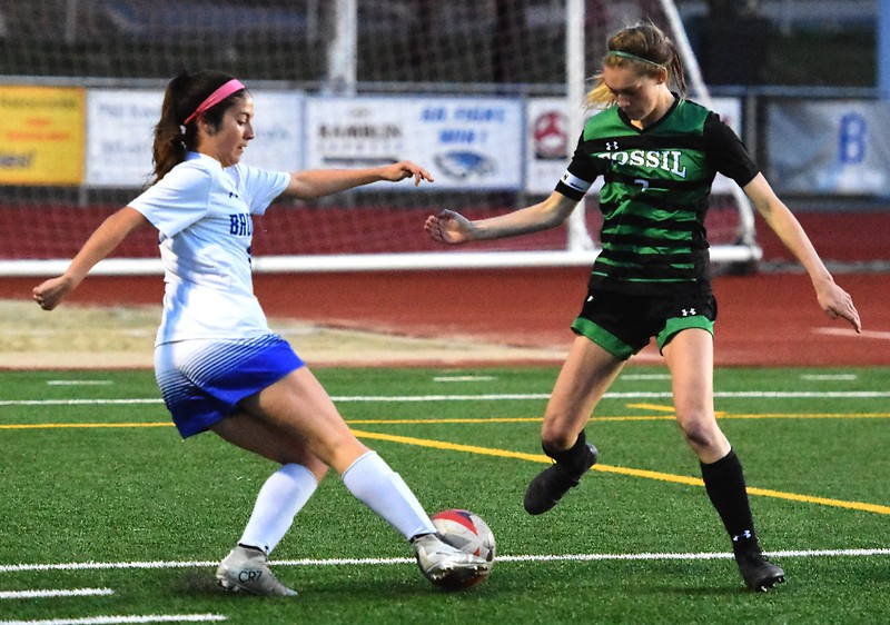 Broomfield's Isabelle Sorge works to get past a defender during the Eagles' game against Fossil Ridge on Tuesday, April 10, at Broomfield High School.