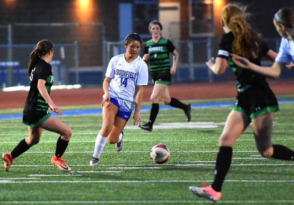 . Broomfield\'s Lindsay Hudson controls the ball during the Eagles\' game against Fossil Ridge on Tuesday, April 10, at Broomfield High School.