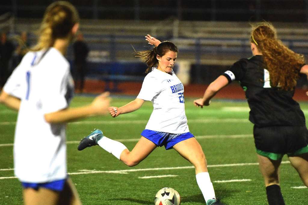 . Broomfield\'s Mallory Mooney lines up a shot during the Eagles\' game against Fossil Ridge on Tuesday, April 10, at Broomfield High School.