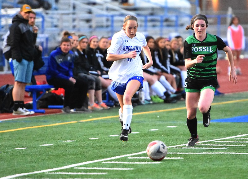 Broomfield's Ashley Tuccio races a defender to the ball during the Eagles' game against Fossil Ridge on Tuesday, April 10, at Broomfield High School.