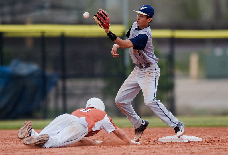 "Frederick's Avery Elkins catches the ball as Mead's Scott Martenson slides into second base during the game at Frederick High School on Saturday. <br /> More photos:  <a href=""http://www.BoCoPreps.com"">http://www.BoCoPreps.com</a><br /> Autumn Parry/Staff Photographer<br /> April 23, 2016"