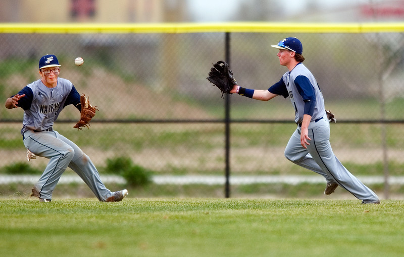 "Frederick's Mario Ramirez (left) and Jake Frenzel eye the ball in the outfield before Frenzel caught it during the game at Frederick High School on Saturday. <br /> More photos:  <a href=""http://www.BoCoPreps.com"">http://www.BoCoPreps.com</a><br /> Autumn Parry/Staff Photographer<br /> April 23, 2016"