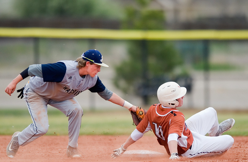 "Frederick's Bryce Shirley tags out Mead's Luke Levine on second base during the game at Frederick High School on Saturday. <br /> More photos:  <a href=""http://www.BoCoPreps.com"">http://www.BoCoPreps.com</a><br /> Autumn Parry/Staff Photographer<br /> April 23, 2016"