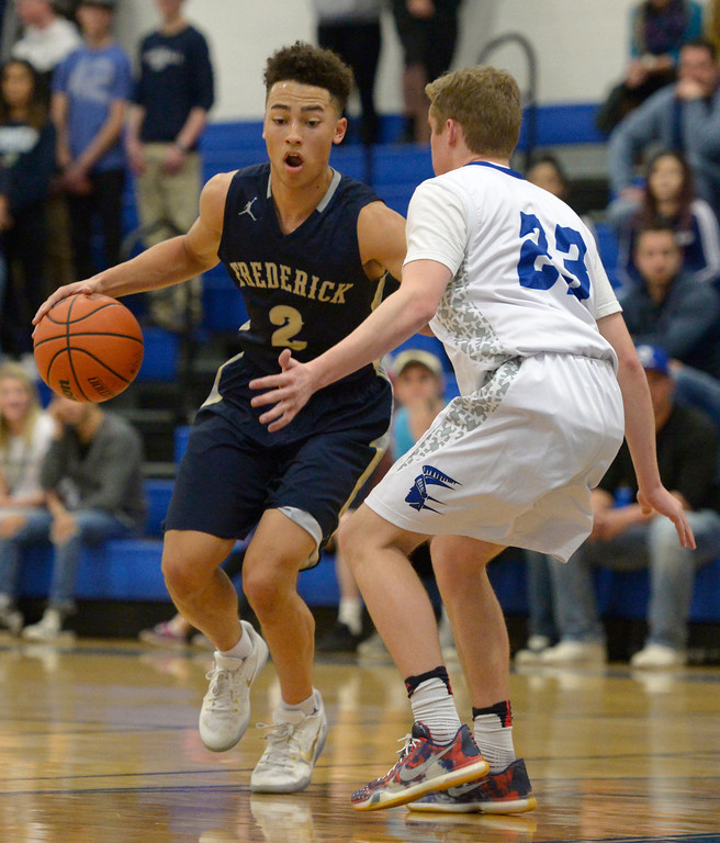. Frederick\'s Nathan Washington handles the ball in front of Longmont\'s Caden Dion in the second quarter Wednesday night at Longmont High School. To view more photos visit bocopreps.com. Lewis Geyer/Staff Photographer Feb. 22, 2017