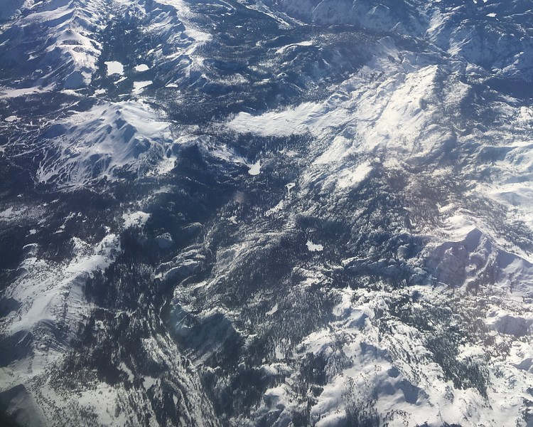 A closer look at Mammoth Mountain Ski Area, Devil's Postpone to the right, and the start of the San Joaquin drainage in the foreground.