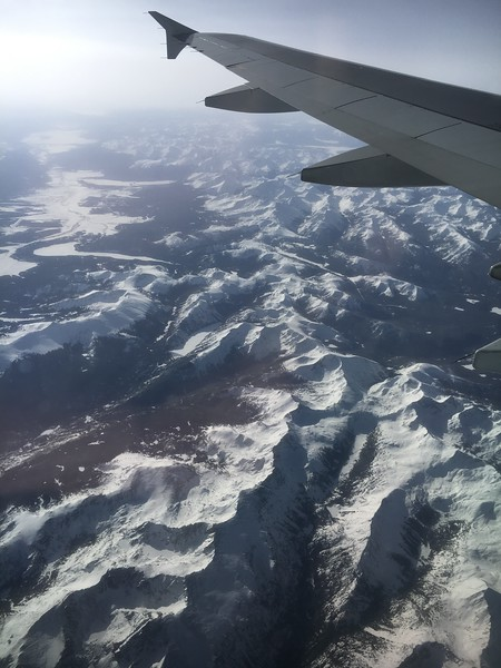 "The Holy Cross Wilderness is in the foreground. A frozen Turquoise Lake is the ""Nike Swoosh"" shaped feature in the middle-left of the photo. Beyond the lake is the Arkansas River drainage, heading to the upper left of the photo (Leadville closer to Turquoise Lake, and Buena Vista somewhere in the upper left of this photo)."