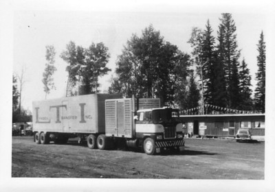 "June 1965 - headed north.  Not sure which lodge this is, can only read ""...River Esso Service"" on the roof.  Lots of Lynden rigs like this on the highway back then, a ""Drom Box"" on the tractor, pulling a 40' trailer."
