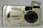 My first digital camera, an Olympus D450Z that had a whole 1.3 megapixels and a 3:1 optical zoom.  It took four AA batteries, that it went through at an astounding rate.