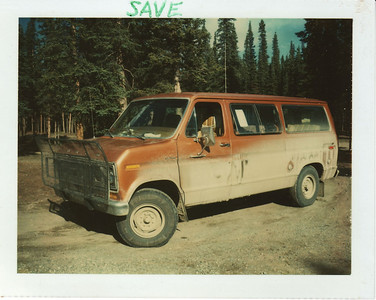 July 1976:  The brand new '76 Ford Club Wagon Chateau being driven home from Ohio, after a few miles of Alcan mud.  Yep - they all ended up looking like that, except in the winter.