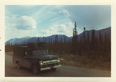 June 1965, somewhere in the Yukon:  When the Alcan was virtually all gravel, it was a good idea to carry a spare tire... or 5.  The '57 Ford 1/2 ton that brought me home after my discharge from the Army.