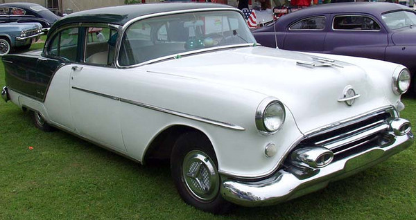 1954 Oldsmobile 88 - The fourth vehicle I owned.  Paid $450 for it, in good shape except that it had been just driven around post on Fort Richardson for a few years and the plugs were badly fouled.  Eight new plugs, and it ran like new.