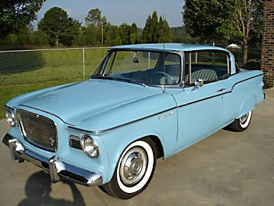 1959 Studebaker Lark - Got that in 1966.  Had a 289 V-8 with a bad main bearing.  Solid little car... good gas mileage.