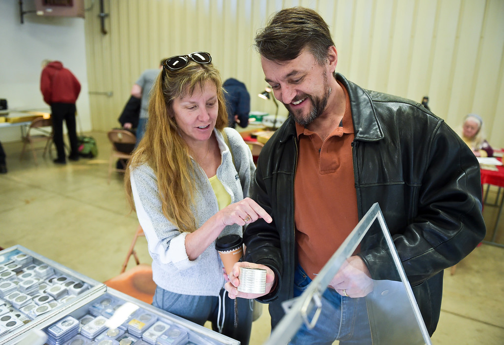 . Sally and John Carrol, of Longmont, look at a collection during the Front Range Coin Club\'s coin show at the Boulder County Fairgrounds Sunday. To view more photos visit timescall.com. Lewis Geyer/Staff Photographer March 11, 2018