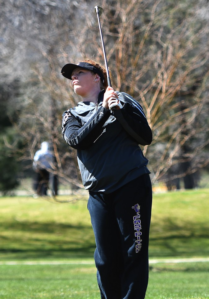 Boulder's Sydney Arthur watches a tee shot during the Front Range League's first tournament of the season on Tuesday, April 3, at Flatirons Golf Course in Boulder.