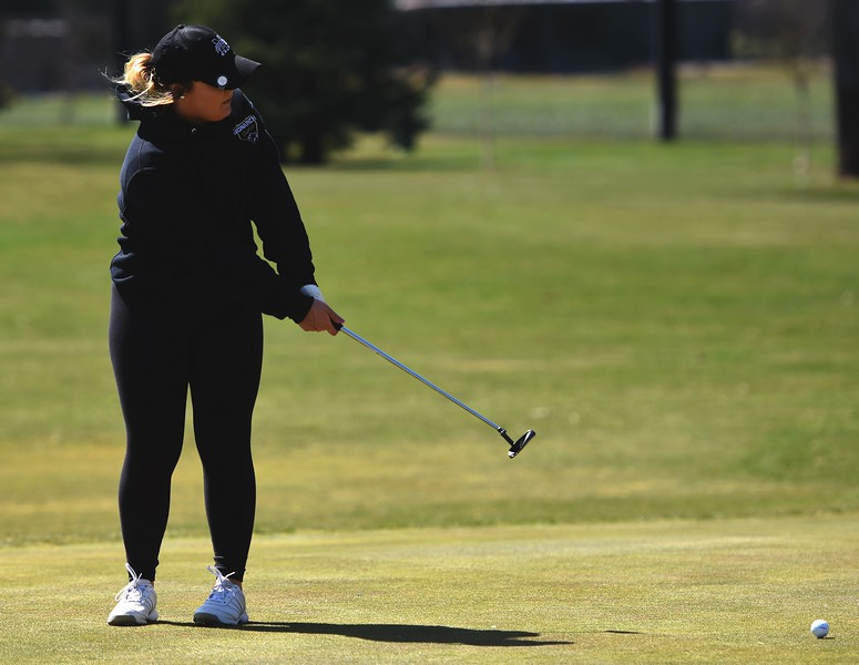 Monarch's Jamie Thompson putts during the Front Range League's first tournament of the season on Tuesday, April 3, at Flatirons Golf Course in Boulder.