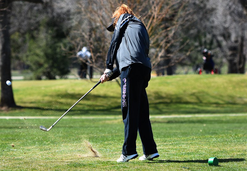 Boulder's Sydney Arthur hits a tee shot during the Front Range League's first tournament of the season on Tuesday, April 3, at Flatirons Golf Course in Boulder.