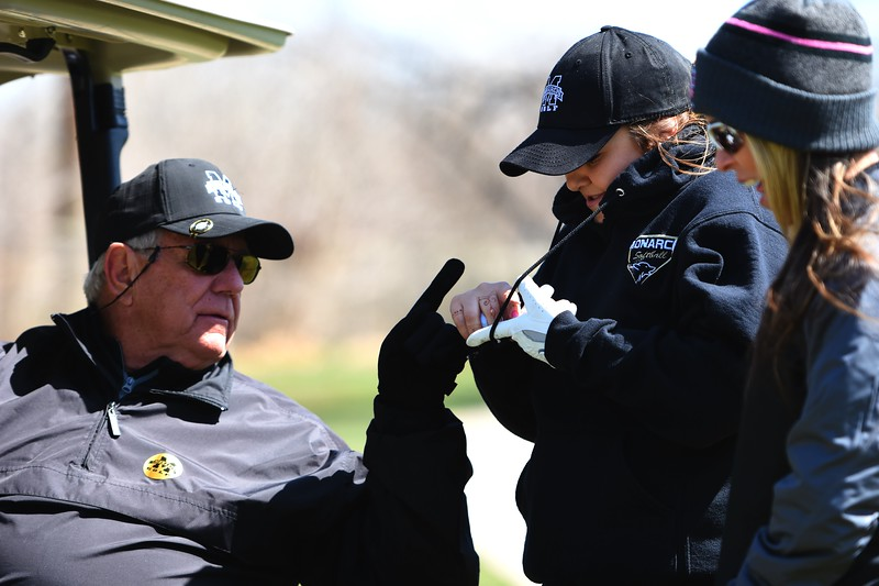 Monarch's Jamie Thompson gets some advice from head coach Michael Riley during the Front Range League's first tournament of the season on Tuesday, April 3, at Flatirons Golf Course in Boulder.